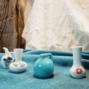 Lot of four adorable mini vases!
